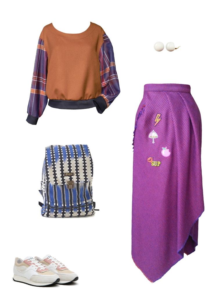 Idée look - Jupe portefeuille asymétrique en laine frangée et écussons brodés